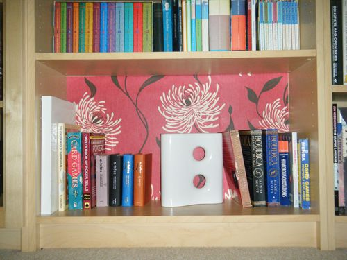 Wallpapered bookshelf 01