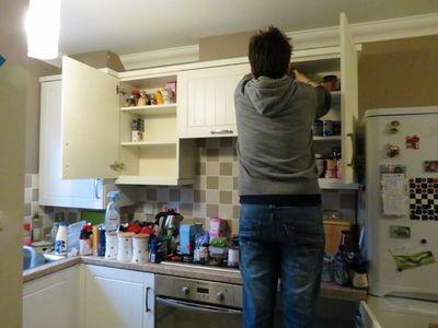 Re-organising kitchen cupboards (1)