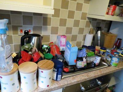 Re-organising kitchen cupboards (2)