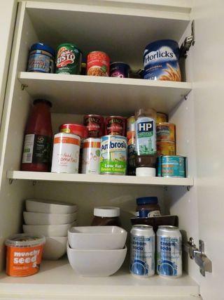 Re-organising kitchen cupboards (4)