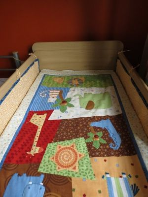 Cot with homemade bumpers and quilt (600x800)