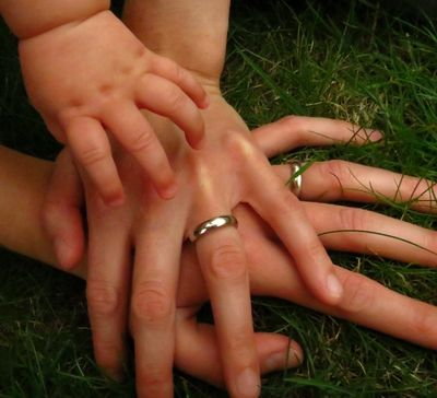 Family photoshoot - pile of hands