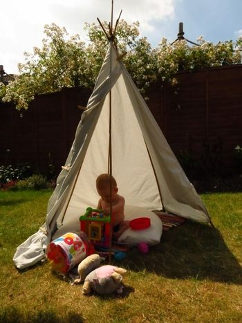 Baby R in his teepee