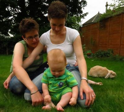 Two women, one baby and a rabbit