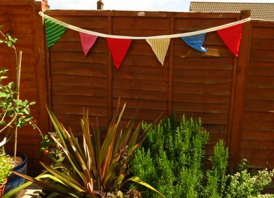 Upcycled fabric party bunting in garden (1) (800x578)